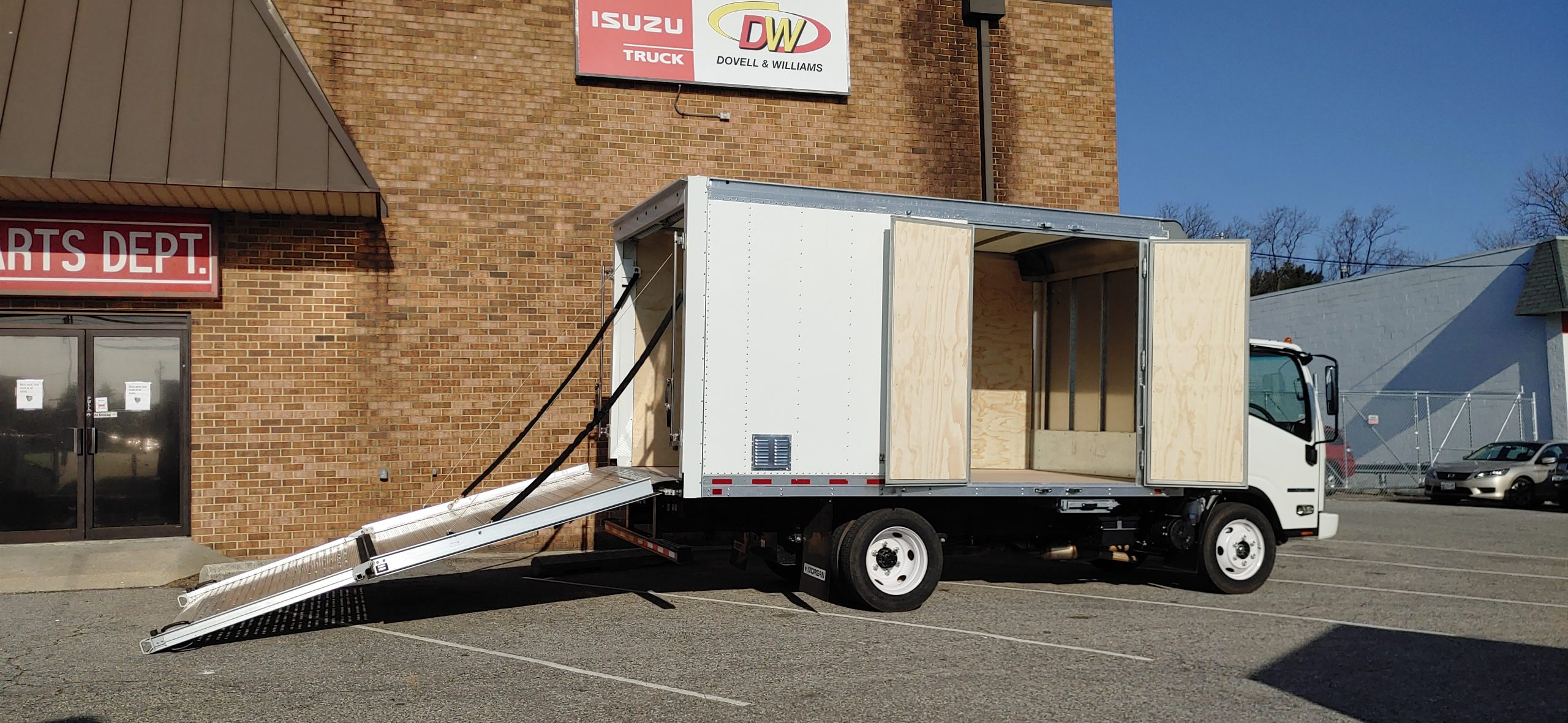 2021 NPR HD Gas Truck with Proscaper Body Pull down Ramp with Side doors 3 year Roadside Assistance 20210304_084940-scaled