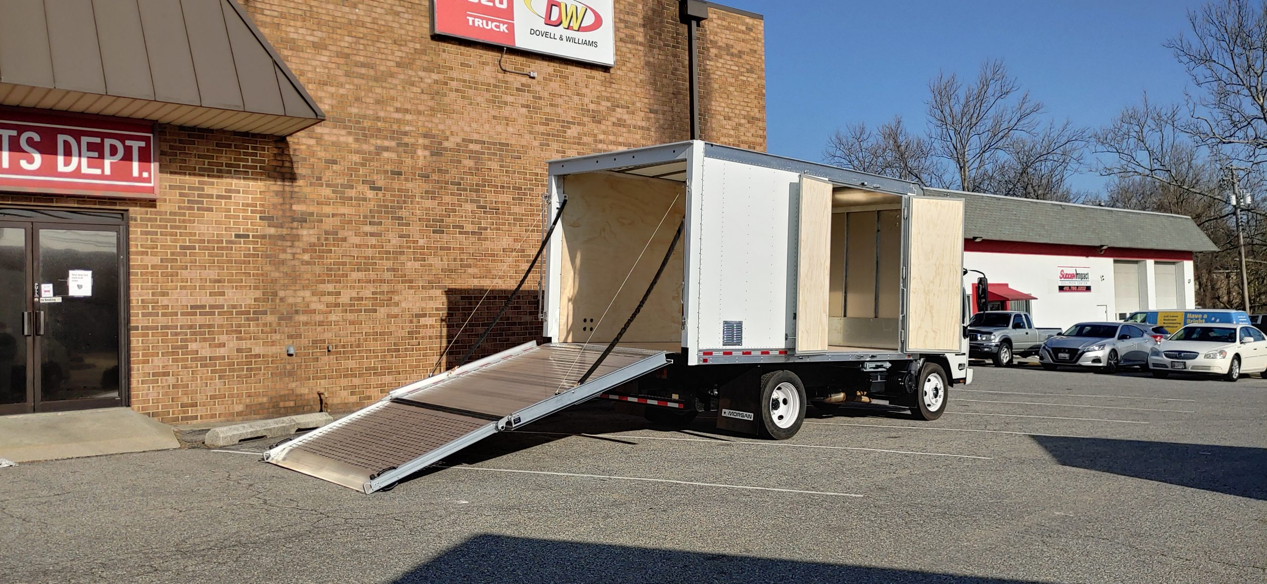 2021 NPR HD Gas Truck with Proscaper Body Pull down Ramp with Side doors 3 year Roadside Assistance 20210304_085003_HDR-scaled